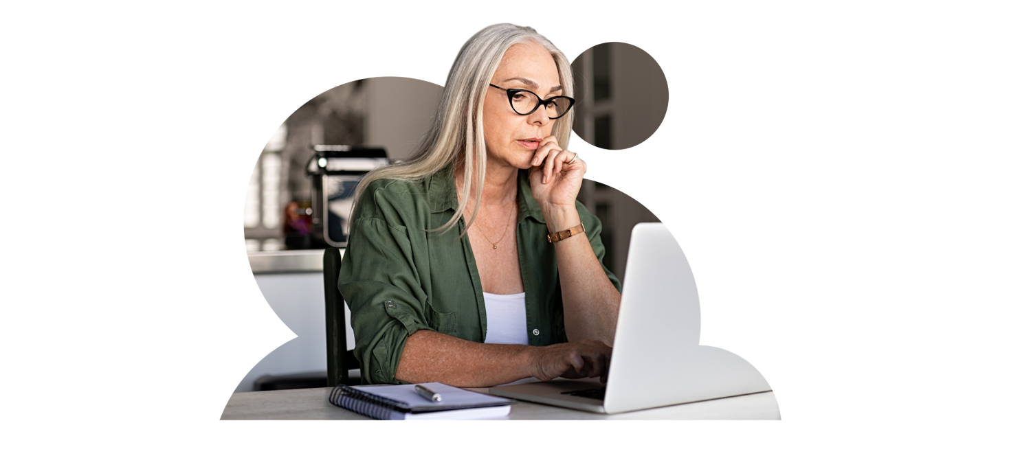 Picture of woman with glasses viewing laptop.
